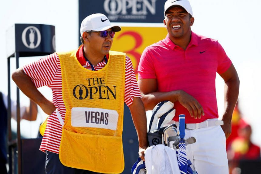 Venezuela's Jhonattan Vegas with his caddie during the first round on July 19, 2018.