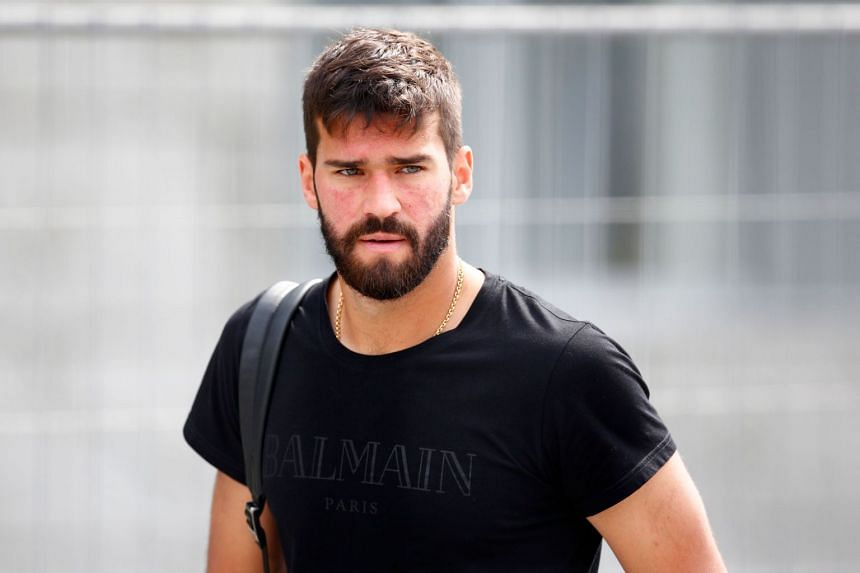 Alisson (above) is cutting short his vacation to undergo a medical after being given permission to talk to Liverpool.