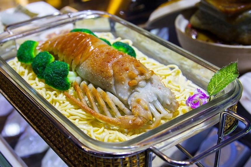 A crustacean carved from jade on display.
