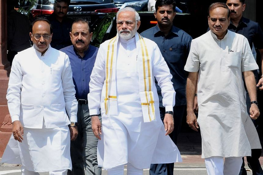 While Indian Prime Minister Narendra Modi (centre) will have the majority needed to defeat the no-confidence motion, the strength of the votes, analysts said, would be a pointer to unity among the opposition parties.
