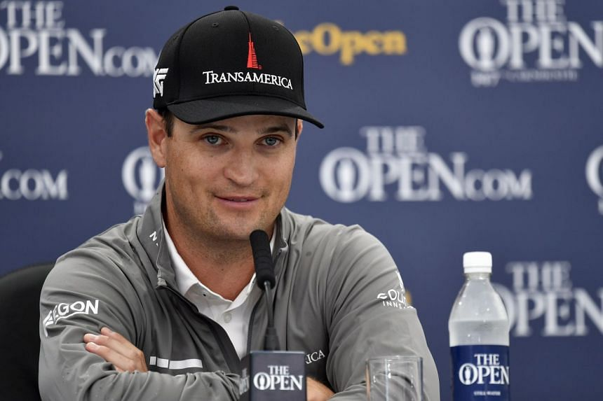Johnson gives a press conference after taking the lead during the second round of the British Open.