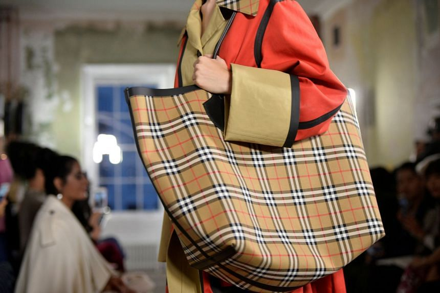 A model with a product from the Burberry Spring/Summer 2018 show at London Fashion Week in London, on Sept 16, 2017. £28.6 million of unsold clothes, accessories and perfume were burned by Burberry in an effort to protect the brand.