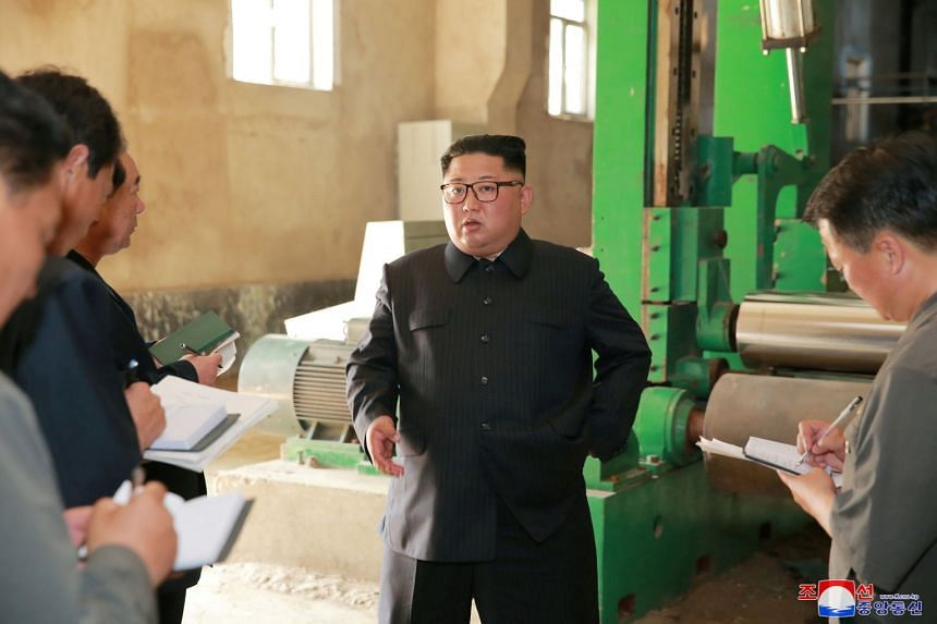 North Korean leader Kim Jong Un tours a factory in Sinuiju, North Korea, in an undated photo.