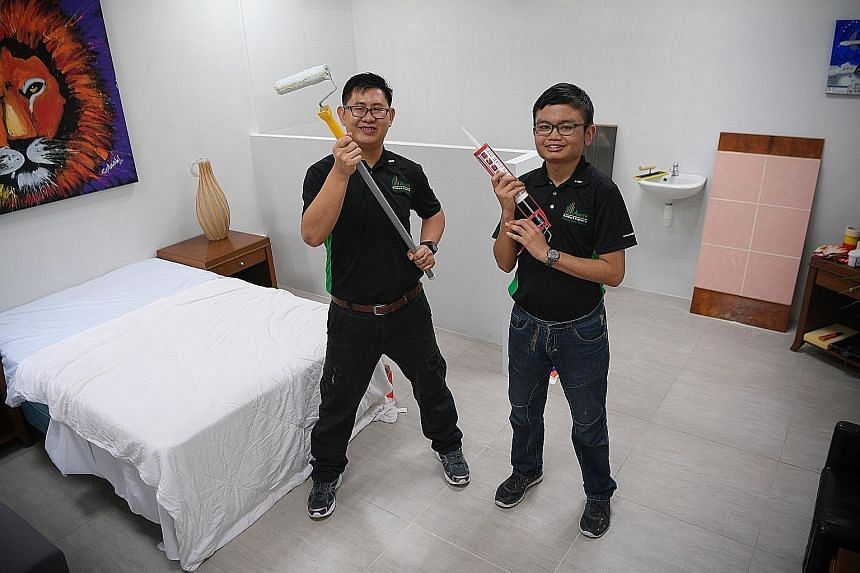 Mr Ng Yi Feng (left) and Mr Muhaimin Afandi, students of the new Building and Facilities Services Programme, in a mock-up of a hotel room in the APSN Centre for Adults. The nine-month course starts with vocational training and includes a six-month ap