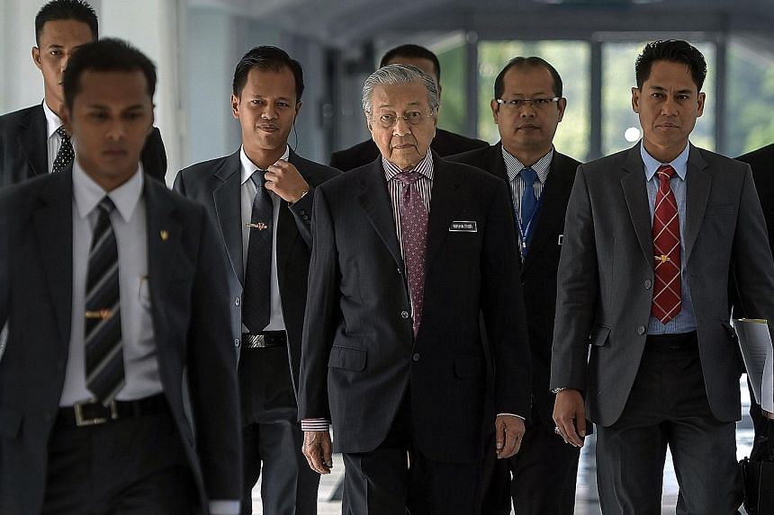 Above: An artist's impression of the Bandar Malaysia station on the high-speed rail line. Left: Malaysian Prime Minister Mahathir Mohamad attending the Parliament sitting yesterday. He said discussions on the high-speed rail project will be carried o