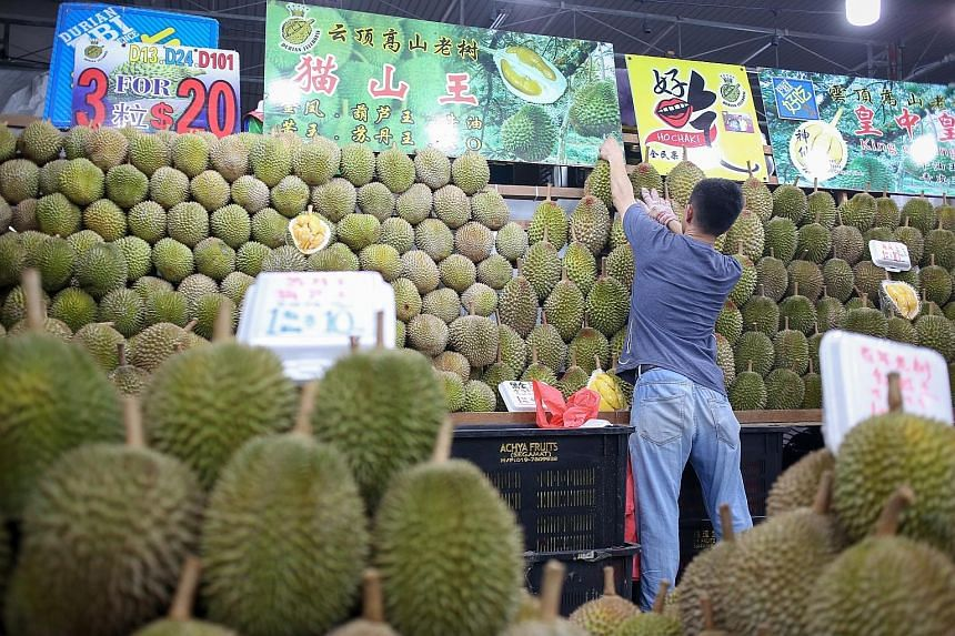 Durians on sale at Durian FullHouse, near Kovan market and food centre. Thanks to good weather in Malaysia, there is a bumper crop of durians.