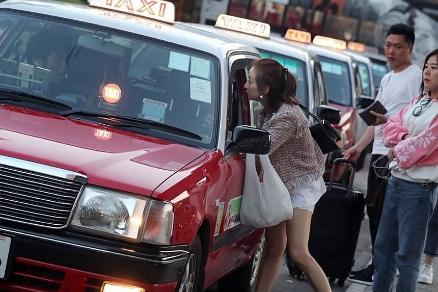 Taxis waiting for passengers in Tsim Sha Tsui, Hong Kong. The heavier penalties, which will undergo discussion, are on top of a proposal for a demerit point system covering 11 of 24 existing road traffic offences.