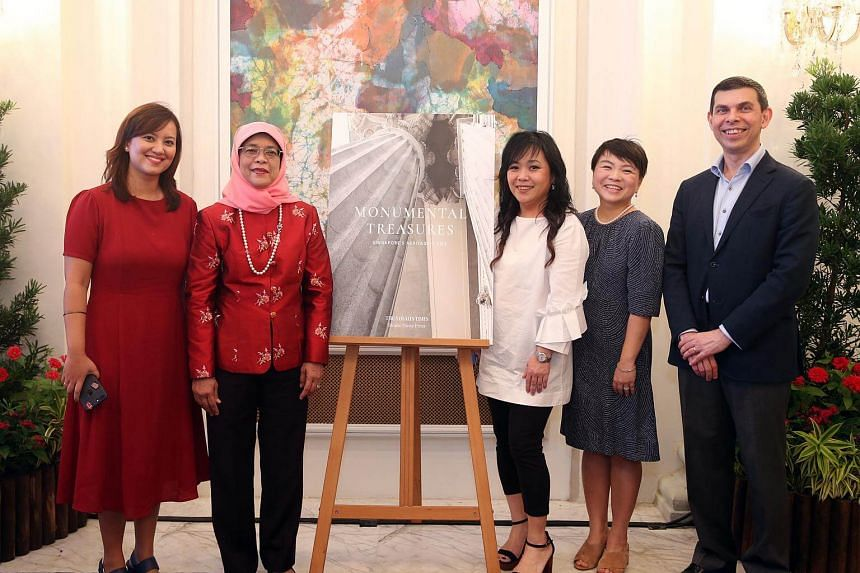 (From left) The Straits Times (ST) heritage and community correspondent Melody Zaccheus, President Halimah Yacob, ST executive designer Sally Lam, who designed the book, ST Press general manager Susan Long and SPH English/Malay/Tamil Media editor-in-