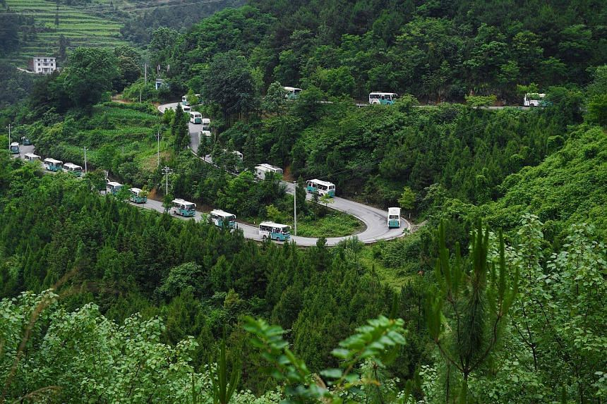 Buses carrying students through the mountains of remote Tongren in Guizhou province, China, where a new 10km track for a high-speed hyperloop transportation system will be built.