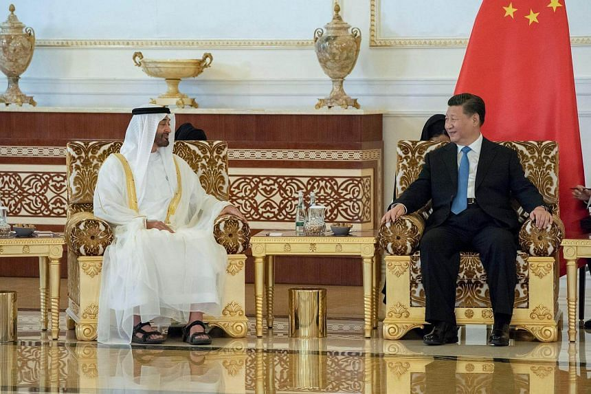 Abu Dhabi's Crown Prince Sheikh Mohammed bin Zayed al-Nahyan (left) meets with Chinese President Xi Jinping in Abu Dhabi, on July 19, 2018.