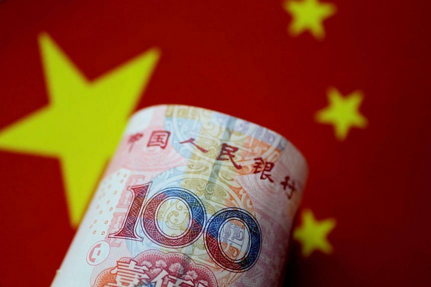 The Chinese yuan fell to 6.7943 per dollar by late morning, with analysts pointing out that a weaker currency aids Beijing in its trade tussle with Washington, on June 20, 2018.
