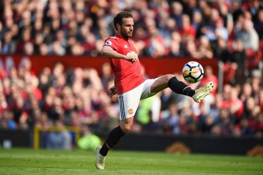 Manchester United's Spanish midfielder Juan Mata controls the ball during the English Premier League football match between Manchester United and Watford at Old Trafford in Manchester, north west England, on May 13, 2018.