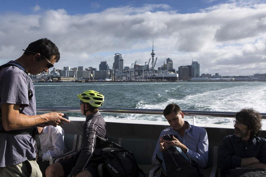A view of downtown Auckland from aboard the Devonport ferry in New Zealand. Too many New Zealanders worked overly long hours, said the government's workplace relations minister.