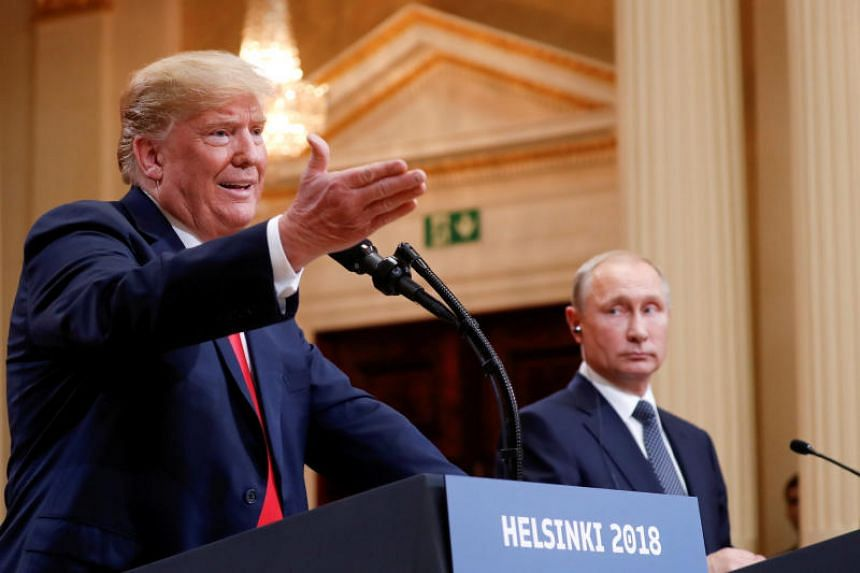 US President Donald Trump gestures during a joint news conference with Russia's President Vladimir Putin after their meeting in Helsinki, Finland, on July 16, 2018.