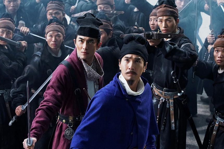 Mark Chao as the titular Detective Dee (right) and Lin Gengxin as Shatuo, Dee's handy sidekick in Detective Dee: The Four Heavenly Kings.