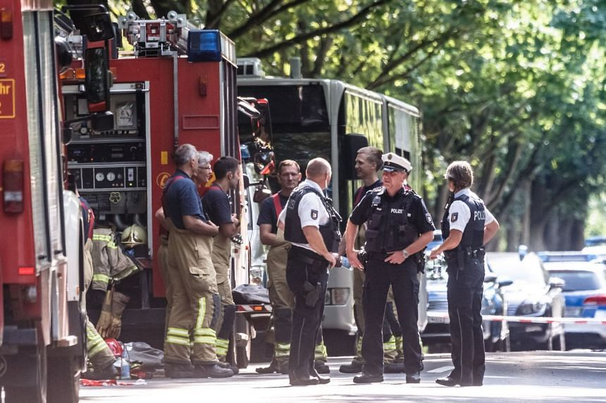 Police officers at the scene of the bus attack in northern Germany.