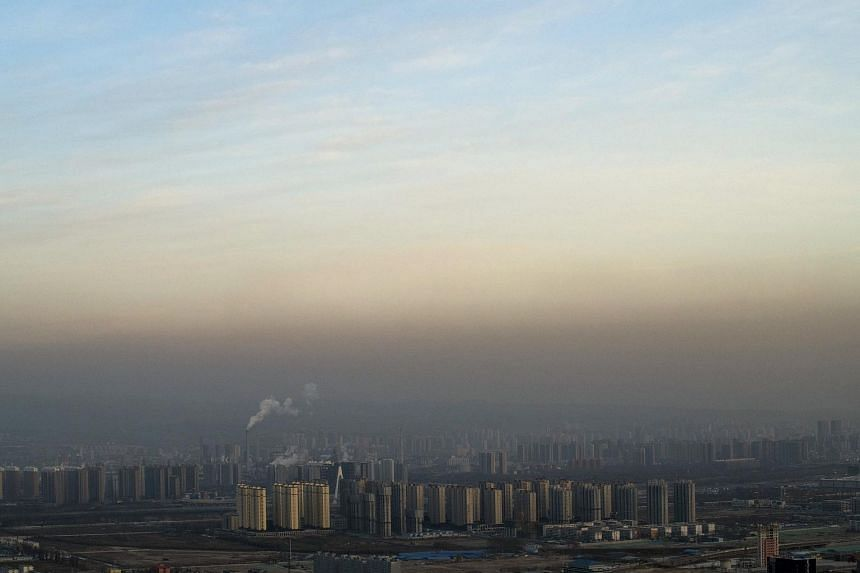 A layer of smog over Taiyuan, China, on Jan 24, 2018. Despite becoming a global leader in climate policy, China needs to take major steps to reduce its carbon dioxide emissions, according to a report released by Columbia University.