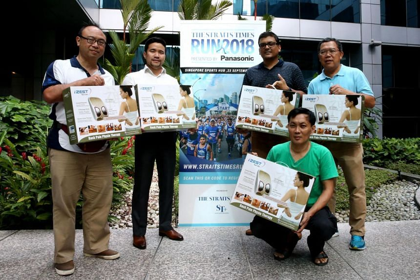 Happy ST Run winners of an iZest Back Zen worth $499 are (standing, from left) Wong Chok Tung, Ton Kuei Lim, Anurag Patra, Ng Kok Hian and Wong Kum Wing (squatting).