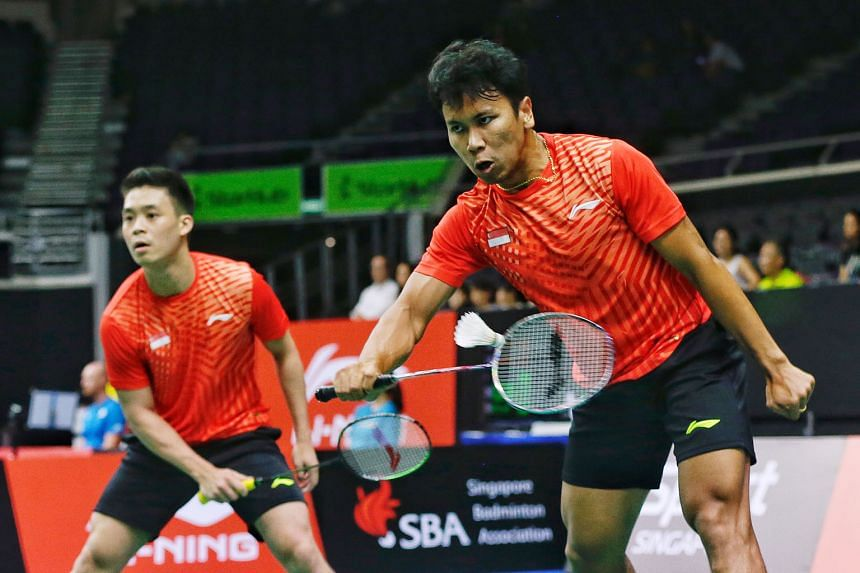 Singapore's Terry Hee (left) and Danny Bawa Chrisnanta lasted 36 minutes before losing 21-18, 21-18 to Thailand's Tinn Isriyanet and Kittisak Namdash yesterday at the Singapore Open.