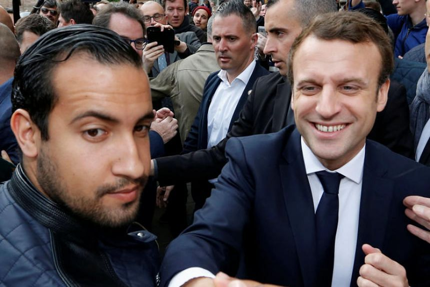 Emmanuel Macron (right) flanked by Alexandre Benalla attend a campaign visit in Rodez, France, on May 5, 2017.