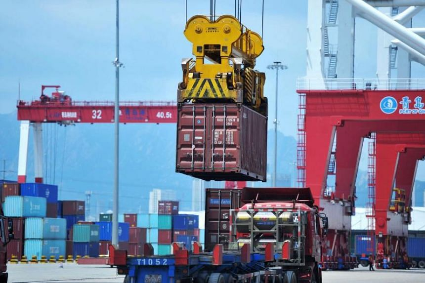 A container is transferred at a port in Qingdao in China's eastern Shandong province, on July 6, 2018.