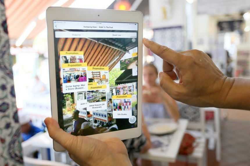 An app is used to hunt for location-based discounts under a new  transformation project for Kampong Glam.