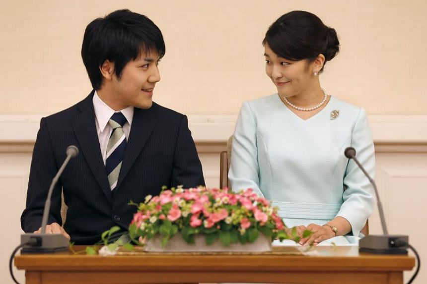 Princess Mako (right), the eldest daughter of Prince Akishino and Princess Kiko, and her fiancee Kei Komuro, at a press conference to announce their engagement at the Akasaka East Residence in Tokyo, on Sept 3, 2017.