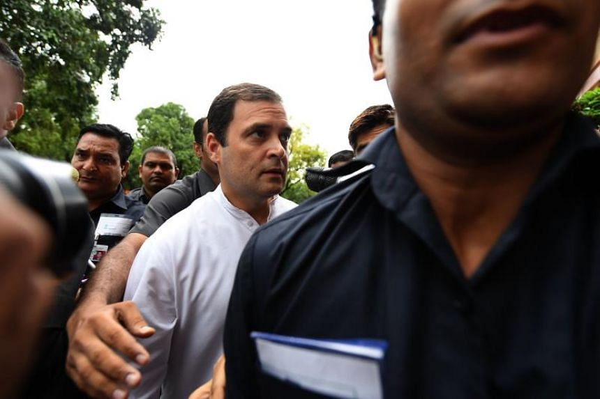 Congress Party President Rahul Gandhi arrives during the monsoon session of the Indian Parliament in New Delhi on July 20, 2018.