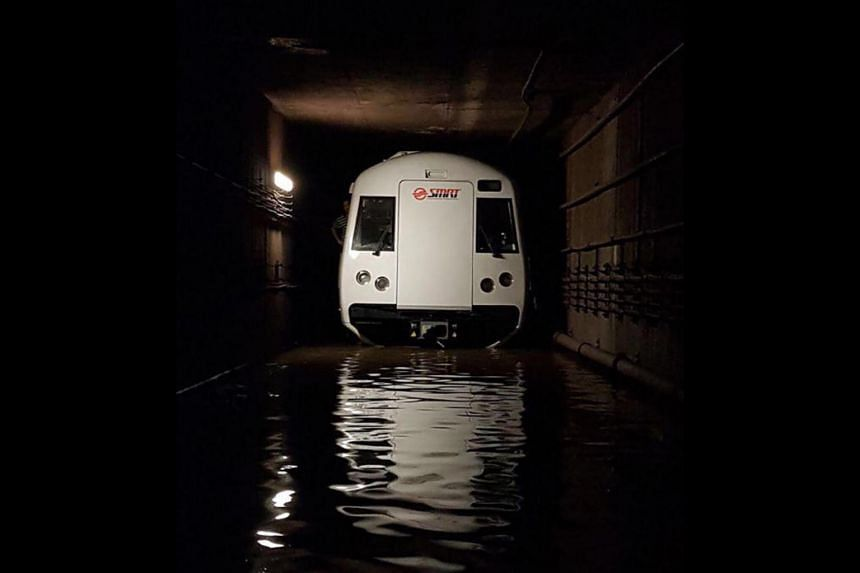 A stalled train in a flooded tunnel between Bishan and Braddell MRT stations, on Oct 7, 2017.