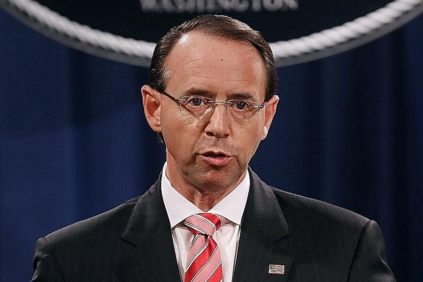 """US Deputy Attorney-General Rod Rosenstein says victims targeted in influence schemes would be informed. A vigil """"to demand democracy"""" and to """"confront corruption"""" outside the White House on Wednesday. It was one of many held across the US to voice cr"""