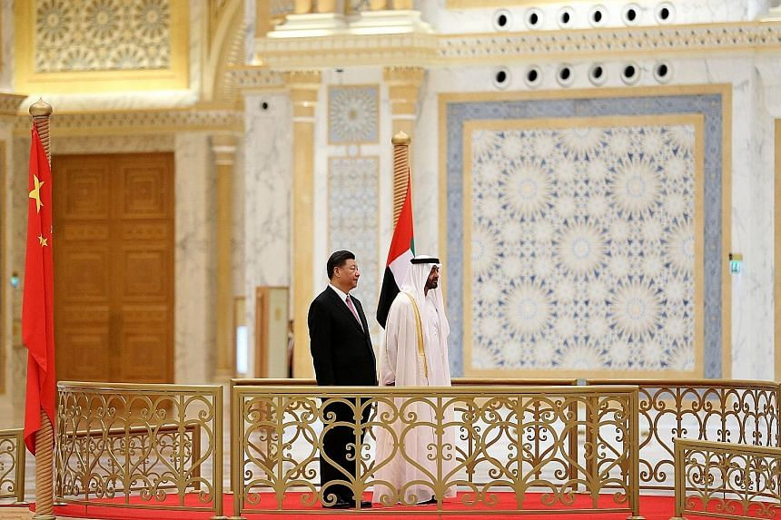 Chinese President Xi Jinping and Sheikh Mohamed bin Zayed Al-Nahyan, Crown Prince of Abu Dhabi, at the presidential palace in the UAE capital yesterday. Mr Xi is on a three-day visit to the UAE.