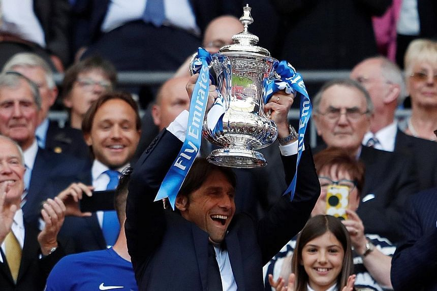 Chelsea manager Antonio Conte lifting the FA Cup - his second and final trophy with the Blues - in May. He had been resigned to being dismissed as far back as January and wants to be compensated for the lack of clarity.