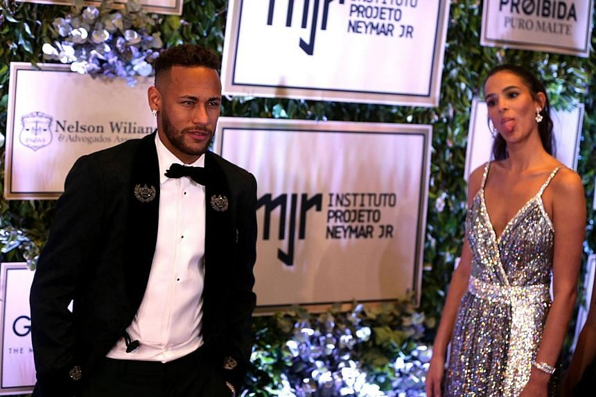 Neymar attends a charity auction in Sao Paulo on Thursday with his girlfriend Bruna Marquezine. It was his first public appearance since the World Cup in Russia.
