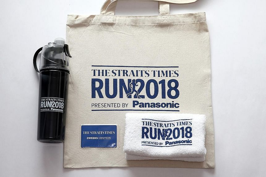 The Straits Times Run 2018 bag contains a cotton tote bag, towel, and a water bottle with a misting feature.