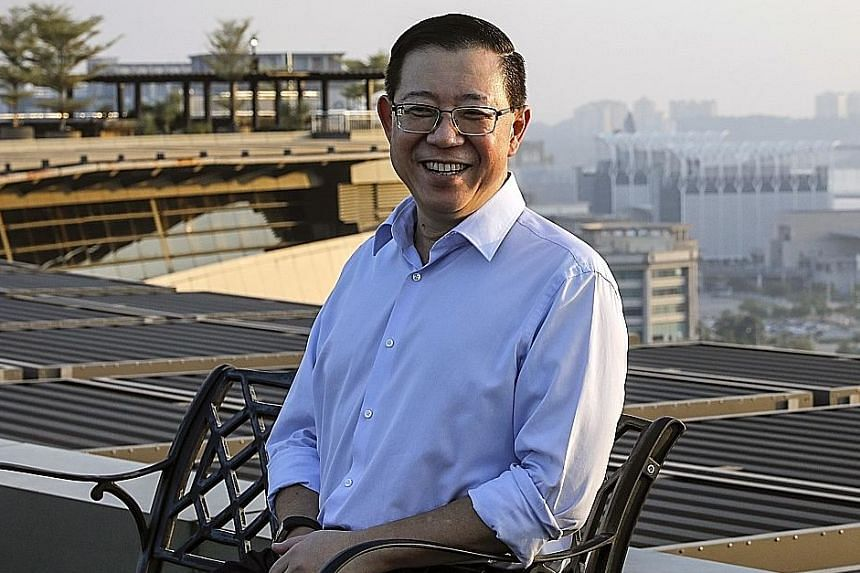 """Finance Minister Lim Guan Eng said the government may be able to regain at least 10 per cent of the RM50 billion (S$16.8 billion) in funds he estimates were siphoned from 1MDB, and up to 30 per cent of the amount """"if we are lucky""""."""