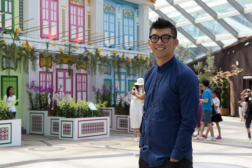 More than 14,000 orchids of 120 varieties are showcased amid tingkat carriers (above) and shophouse facades at the Orchid Extravaganza. Its creative director is Singaporean film-maker Royston Tan (left).