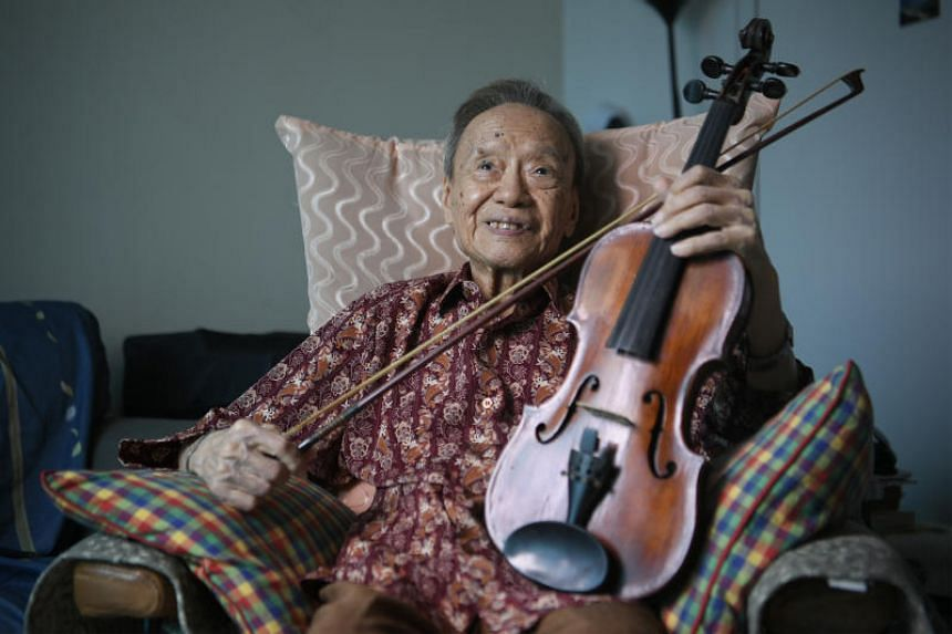 Julai Tan, 93, the oldest performer at the National Day Parade this year, pictured with his violin at his home on July 19, 2019.