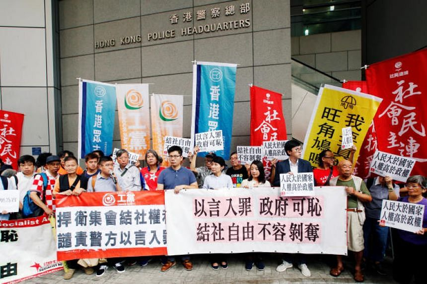Pro-democracy activists take part in a protest against a government process which could lead to a ban on a group that promotes secession from China, outside the police headquarters in Hong Kong, on July 18, 2018.