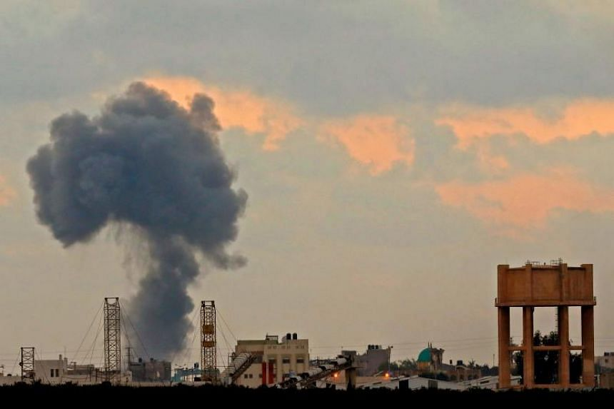 A smoke plume rising from an explosion during Israeli bombardment in Gaza City, on July 20, 2018.