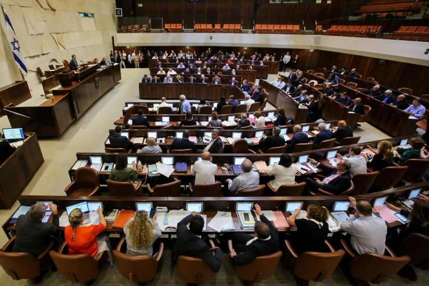 Israeli members of parliament attend the Knesset Plenary Hall session ahead of the vote on the National Law which refers to Israel as the historic homeland of the Jews, on July 18, 2018.
