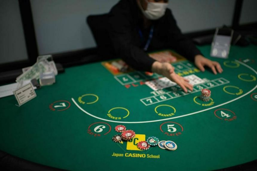 A student practices Baccarat at the Japan Casino School in Tokyo.