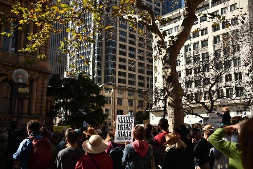 Demonstrators gather for a protest march to demand humane treatment of asylum seekers and refugees, in Sydney, on July 21, 2018.