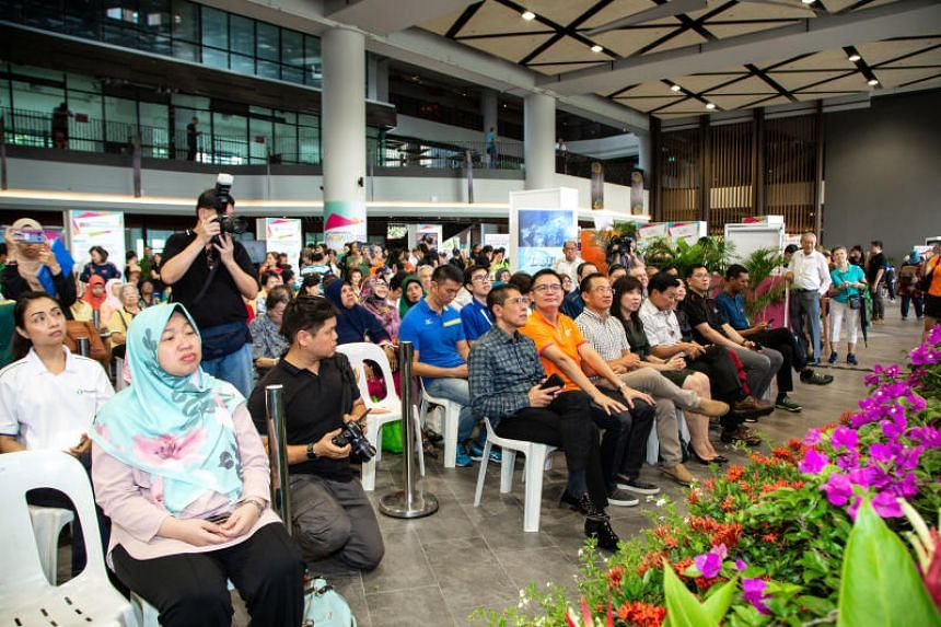 Officials from 15 government agencies and organisations were at the Wisma Geylang Serai building to help residents understand new policies and advise on how to upgrade skills on July 21, 2018.