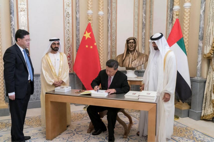 Chinese President Xi Jinping signs a book at the Presidential Palace in Abu Dhabi, on July 20, 2018.