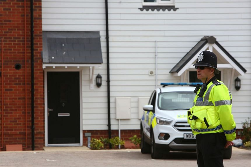 A police officer stands guard outside Rowley's house in Amesbury, southern England, on July 4, 2018.