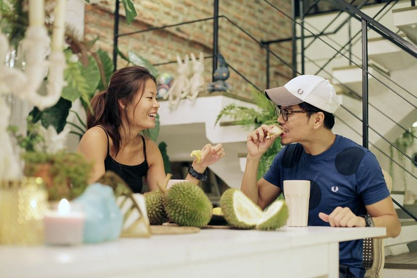 Durian lover Jit Lim enjoying durians with his niece Goh J-Ing.