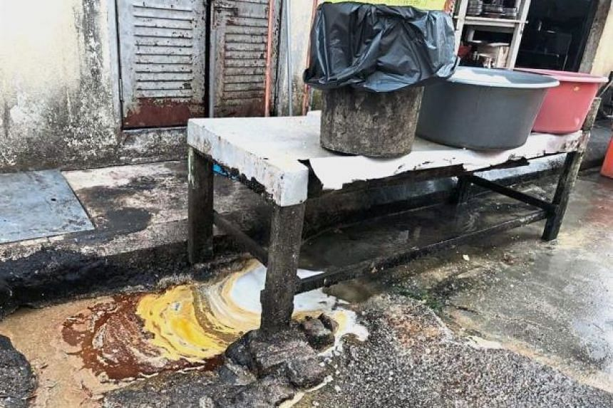 Sekinchan Guan Huat Restaurant uses the back lane as a kitchen to wash and prepare food where oil and food scraps enter the drains. The restaurant has been issued a 14-day closure notice.