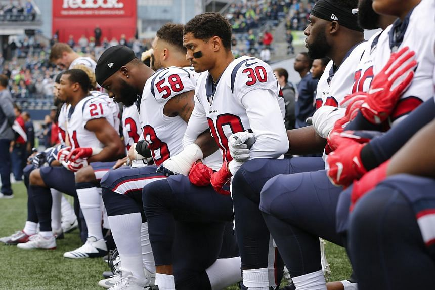 File photo showing the Houston Texans kneeling during the Football League's (NFL) national anthem in Seattle. NFL's recent controversial policy requires players and all team personnel on the sidelines to stand during the traditional playing of Th