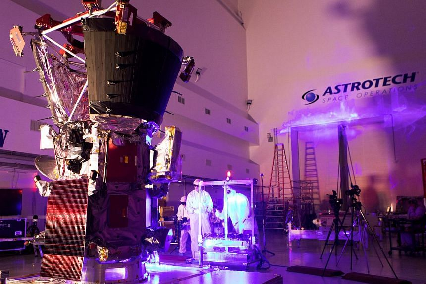 Technicians and engineers perform light bar testing on Nasa's Parker Solar Probe in the Astrotech processing facility near Nasa's Kennedy Space Center, in Titusville, Florida, US, on June 5, 2018.