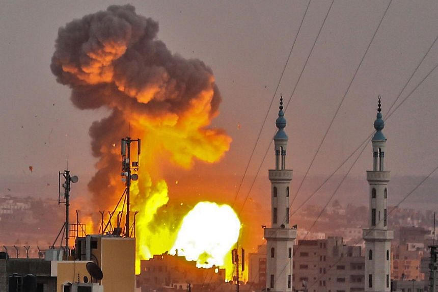 A fireball exploding in Gaza City during the bombardment from Israelis aircraft and tanks across the Gaza Strip, on July 20, 2018.